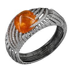 L'Odyssée de Cartier Parcours d'un Style 'Africa' high jewelry bracelet in White gold, one 104.06-carat cabochon-cut mandarin garnet, brown diamonds, brilliants