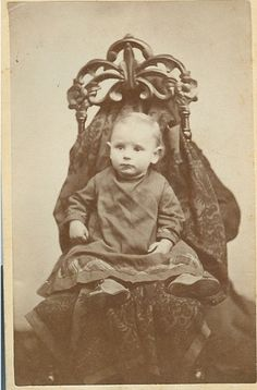 victorian mothers hiding to keep the baby's calm for the photo