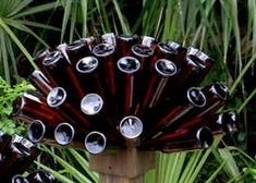 Beer Bottle Tree The Bottle Cap by GnakedGnomery on Etsy Bottle Cap Crafts, Diy Bottle, Blue Bottle, Bottle Torch, Bottle Rack, Brown Bottles, Glass Bottles, Beer Bottles, Bud Lite