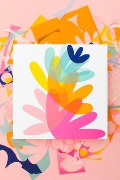 The iconic Fiskars Orange-Handled Scissors turn 50 and we are celebrating by creating colorful wall art using the classic scissors to cut colored vellum.