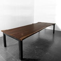 3X3 BASE TABLE  70-144L x 30-50W x 29.5H  Base: blackened steel, powder coat. Slab wood: claro walnut, black walnut, english elm, cherry, maple, pine. Wood: ebony walnut, natural walnut, bone ash, grey ash, cerused oak. Reclaimed wood: antique pine, snow fence.  Uhuru Design
