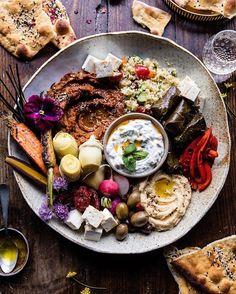 Meze Platter With Roasted Red Pepper And Walnut Spread, Hummus And Tzatziki via @feedfeed on https://thefeedfeed.com/halfbakedharvest/meze-platter-with-roasted-red-pepper-and-walnut-spread-hummus-and-tzatziki