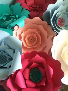 Paper flowers for wedding backdrops or photo walls. Make a big bold statement at your wedding or event. Also available in ivory and white.