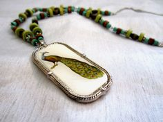 Peacock Portrait necklace by WistfulWhimsyDesigns on Etsy, $22.00