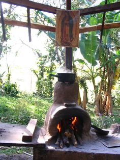 Rocket Stove?  The opening is so big. I thought there was a mathematical formula, hmmm.  I'll have to learn more.