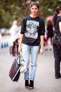 EMILY WEISS INTO THE GLOSS   This Is It — A Look Back at the Year's Best Street Style: Acid-washed jeans and an old-school t-shirt got a dressed-up counter in open-toed booties and a chic, burgundy carry-all.