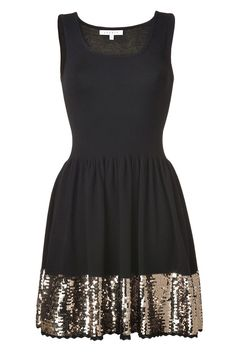 black sequin bottom dress... just add a big red belt and some red high heels :)