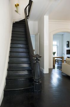 All black staircase. Old structures juxtaposed with modern elements in this brownstone. Black Staircase, Wood Staircase, Spiral Staircases, Staircase Ideas, Staircase Design, Bannister Ideas, Painted Staircases, Interior Staircase, Wooden Stairs