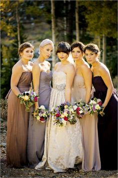 Bridesmaids dresses in purples and neutrals