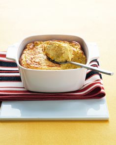 Cheddar-Corn Spoon Bread | Martha Stewart Living - Spoon bread, a classic Southern side dish, is actually more like a pudding than a bread. It's so soft, it can be served -- and eaten -- with a spoon.