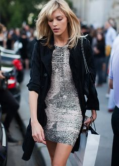 Anja Rubik making a silver sequin mini dress look effortless and utterly appropriate for day with a crinkled black trench