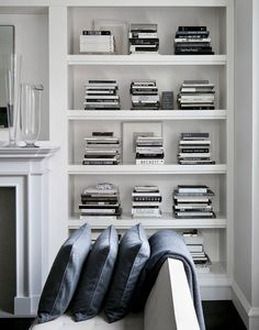 Stacking books like this give your bookcase style but is a great way to provide order and interest.