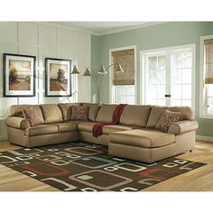 In the living room.  Signature Design by Ashley® Aveline 3-Piece Sectional