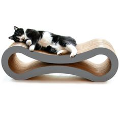 Cat scratcher and lounger in one! Specially made for cats who enjoy scratching, playing, and lounging around. Designed for owners looking to reclaim their homes from expensive furniture scratches, misplaced cat hair, and unattractive pet products. Happier cat and owner guaranteed! No assembly required. Naturally attracts cats; curves make for easier scratching and a more comfortable place to rest and play.