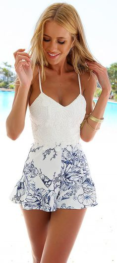 - Cute playsuit jumpsuit beach short dress for the stylish woman - Lovely floral print design adds a unique look - Great for the beach or any casual outing - Available in 4 sizes
