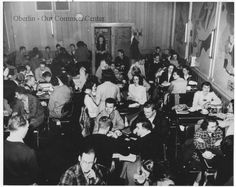 ID#0327 Date: Unknown. This photo shows customers inside the Varsity Restaurant, which opened at 35 West College in 1927. It was a long-standing college student and local resident hangout. Bertha and Bob Rogers owned the restaurant originally. The building was demolished for the construction of the new bookstore in 1993. Participant: Oberlin College Archives. Additional Sources: Oberlin Heritage Center: Fred Maddock files; Letter from R. Lothrop 10/5/00; Loretta Neal Interview 11/00.