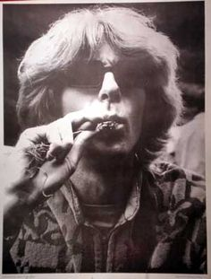 Phil Lesh of the Grateful Dead smoking a joint!