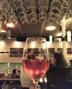 When the glasses hanging above the bar seem to symbolize those brut rosé bubbles in your glass.