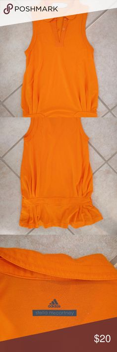 Stella McCartney for Adidas orange golf shirt Great used condition. Stella McCartney for Adidas orange golf shirt. Pleating and banded detail. Super comfortable performance wear for a day on the green. Adidas by Stella McCartney Tops