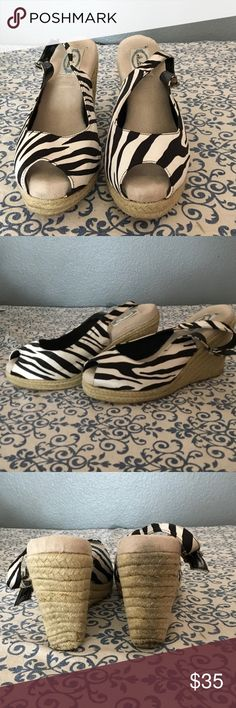 """Vegas Baby! Italiana zebra striped wedges! ❤👠❤ The most comfortable wedges you will ever own.  These wedges have almost an inch of foam to cushion your foot while dancing!   Made by Italiana, these zebra peep toes are in a size 9M.  Heel is 4"""".  Front platform is 1"""".  I picked these up when I managed boutiques at Ballys.  Super adorable. Italiana Shoes Wedges"""