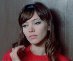 Anna Karina in Une femme est une femme (1961) - pink lip, blue shadow, serious cat eye