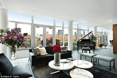 Room with a view: Panoramic views from the living room, with floor-length windows allowing...