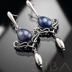 Grace  An exclusive pair of elegant, silver earrings with charming cyanite. Entirely hand made, using the wire-wrapping technique. $202.85 Click to see details!
