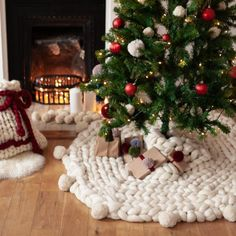 The most beautiful giant knitted tree skirt - perfect for a cosy Christmas home to display all your gifts under your tree. Festive, cosy and tactile - a real statement piece Knitted Christmas Decorations, Cosy Christmas, Crochet Christmas Trees, Christmas Knitting, Scandinavian Christmas, Christmas Home, Christmas Holidays, Christmas Crafts, White Christmas Tree Skirt