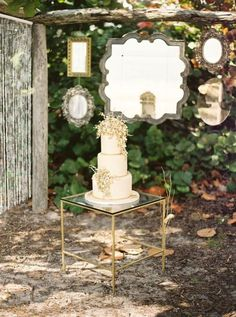 bride2be:    i love the hanging mirrors behind the cake, the beaded curtain, and that piece of glass with a silhouette etched into it!    adoring.