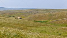 Rural view ...  Apulia, agriculture, alone, beautiful, blue, building, calm, country, countryside, environment, europe, european, farm, farmland, field, grassland, hill, hillside, hilly, horizon, house, italian, italy, land, landscape, meadow, nature, one, outdoor, panorama, pastoral, pasture, peaceful, picturesque, rural, rustic, scene, scenery, seasonal, seasons, single, sky, southern, summer, terrain, tree, typical, valley, view, vista