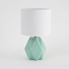 These petite table lamps are perfect for bedrooms, studies and living areas! Our Nia lamps have a simple shade and a contemporary geometric base, available in a range of on-trend colours. Pair with metallic accessories for the best look.