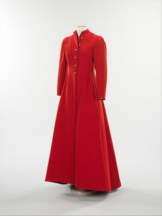 Coat.  Elsa Schiaparelli  (Italian, 1890–1973).  Manufacturer: Textile by F. Ducharne Silk Co., Inc. Artist: Buttons by Jean Cocteau (French, 1889–1963). Date: winter 1935–36. Culture: French. Medium: wool, metal. Dimensions: Length at CB: 60 in. (152.4 cm).