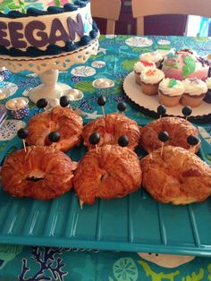 I made these crabby sandwiches with croissant bread and black olives on toothpicks. The perfect food for any ocean or mermaid themed party. #mermaidparty
