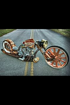 Steampunk bobber motorcycle...  Its a thing of art.. Love it