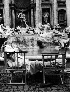 Anita Ekberg warming up on the set of La Dolce Vita after wading in the Trevi Fountain (1959)