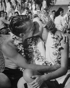 Sailor kisses girl during luau for Navy personnel on leave / photo by Eliot Elisofon, Hawaii, 1945.