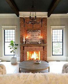 47 Awesome Small Fireplace Makeover Decoration Ideas - nicolette news Red Brick Fireplaces, Small Fireplace, Farmhouse Fireplace, Living Room With Fireplace, Fireplace Design, Fireplace Ideas, Brick Fireplace Decor, Fireplace Remodel, Fireplace Between Windows
