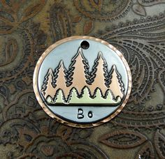 """Personalized Fun in the Woods Dog ID Tag. Love to hike with your dog? Does you dog love to run and explore in the woods? This hand crafted dog ID tag let's everyone know your dog has """"Fun in the Woods"""". This tag features a copper back, nickel silver top, with one hand cut brass …"""
