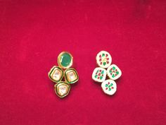 Kundan earrings with green semi precious stone and green front mina and full mina design in back.