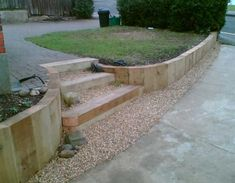 A retaining wall is a perfect DIY project for a variety of skill levels. We have rounded several retaining wall ideas to decorate and build your landscape. Sleeper Retaining Wall, Garden Retaining Wall, Garden Paving, Garden Steps, Retaining Walls, Sloped Backyard, Sloped Garden, Rustic Landscaping, Front Yard Landscaping