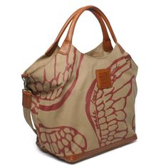 Soft red wings give this functional handbag just a hint of glamour. Make LOVE Not TRASH