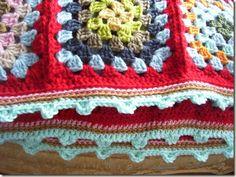 granny scrap blanket. Love the edging.