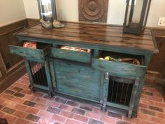 Talk about a fabulous credenza!! This indoor double dog kennel serves as a functional piece of furniture for your dogs, as well as a great entertainment piece! Beautifully turquoise distressed finish. Center interior door to allow pups to be separate or leave it opened for a large den for them to be together! Get rid of that ugly wire crate!