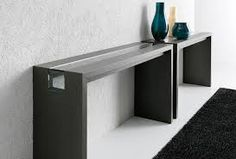 Long, slim and elegant console table. Discover more: modernconsoletables.net | #longconsoletable #modernconsoletable #contemporaryconsoletable
