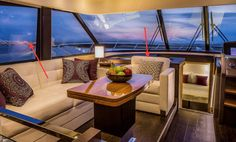Tiara Yachts - 50 Flybridge: Windows on each side of the salon open and the backrest on the one-person seat at the forward end of the lounge is reversible so the passenger can face forward when underway.