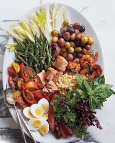 This composed salad is made from leftover salmon; shrimp; and whatever raw, grilled, or blanched vegetables you have on hand. The beauty is, it doesn't matter if you have two shrimp or 10, half an avocado or two. Use what you have -- the more varied it is in color and texture, the more impressive it will look.