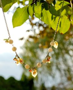 Melon, Pink, and Pear Green Glass Flower Necklace with White Shell Beads on Silver. $25.00, via Etsy.