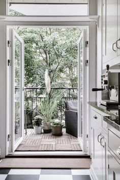 amazing white kitchen and balcony: