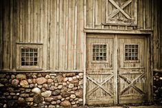 old stone foundation with no ledge. Wood vertical trim...  barn ...