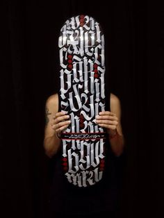 Calligraphy on skate board by Luis Garcia